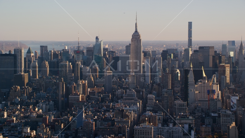 Empire State Building and Midtown skyscrapers at sunrise in New York City Aerial Stock Photos | AX118_168.0000173F
