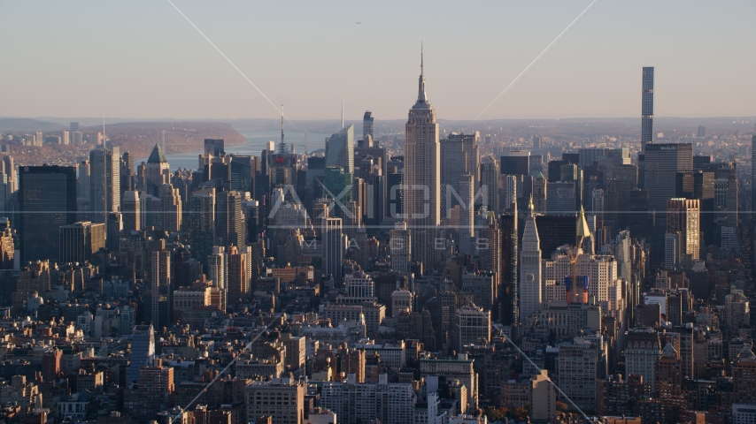 Empire State Building and Midtown Manhattan buildings at sunrise in New York City Aerial Stock Photos | AX118_169.0000092F