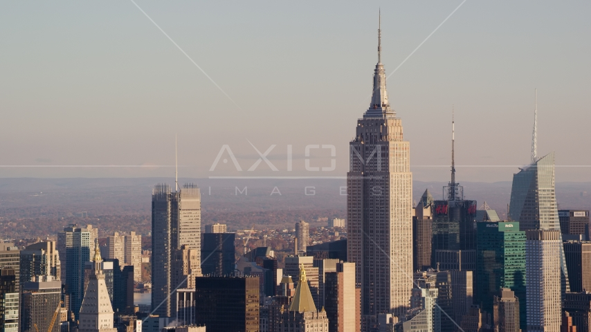 The Empire State Building in Midtown Manhattan at sunrise in New York City Aerial Stock Photos | AX118_174.0000088F