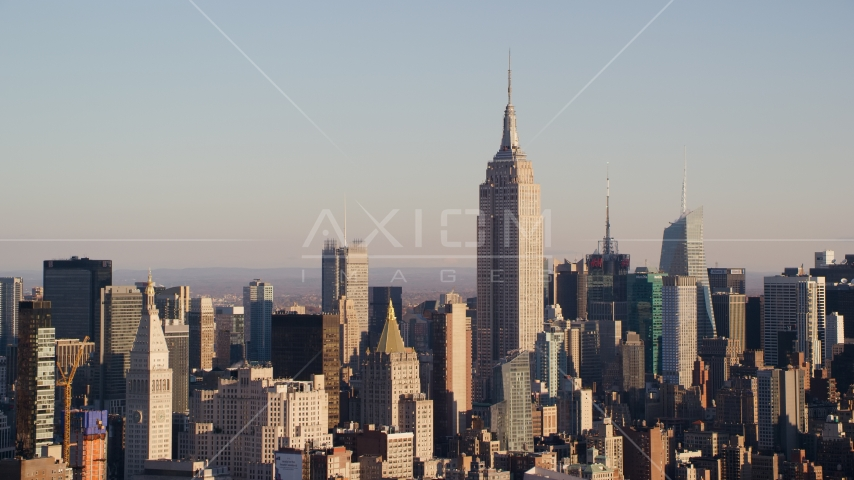 Empire State Building and Midtown high-rises at sunrise in New York City Aerial Stock Photos | AX118_176.0000000F