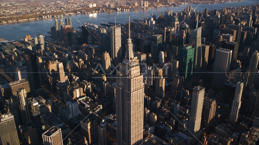 Empire State Building at sunrise in Midtown Manhattan, New York City Aerial Stock Photo AX118_181.0000135F | Axiom Images