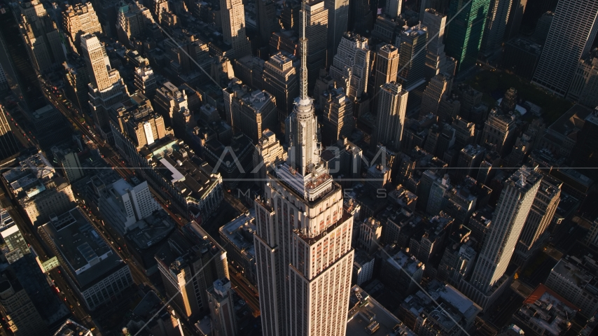 Empire State Building and spire at sunrise in Midtown Manhattan, New York City Aerial Stock Photos | AX118_182.0000195F