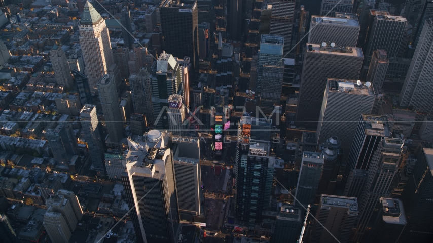 Giant screens at Times Square at sunrise in Midtown Manhattan, New York City Aerial Stock Photos | AX118_185.0000000F