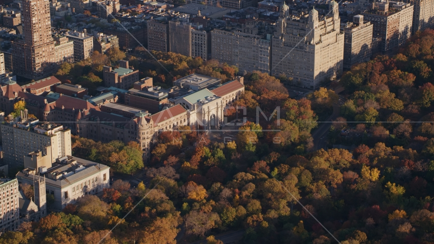 Museum of Natural History and autumn leaves at sunrise in Upper West Side, New York City Aerial Stock Photo AX118_191.0000274F | Axiom Images
