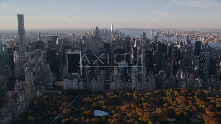 Midtown skyscrapers and Central Park in Autumn at sunrise in New York City Aerial Stock Photos | AX118_196.0000150F