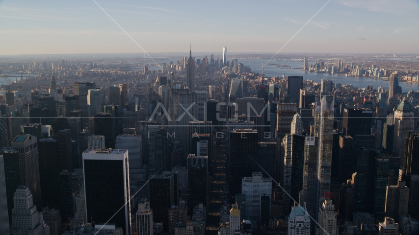 Midtown Manhattan skyscrapers at sunrise in New York City Aerial Stock Photos AX118_197.0000231F
