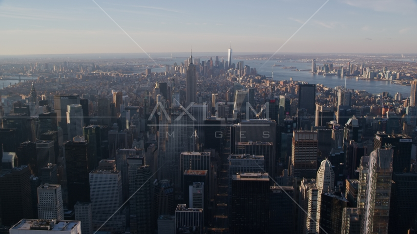 Midtown and Downtown Manhattan skyscrapers at sunrise in New York City Aerial Stock Photos | AX118_198.0000141F