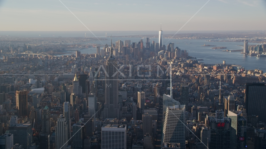 Empire State Building and Downtown skyscrapers at sunrise in New York City Aerial Stock Photos | AX118_200.0000105F