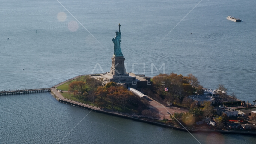 The back of Liberty Island and the Statue of Liberty in Autumn, New York Aerial Stock Photos | AX119_013.0000083F