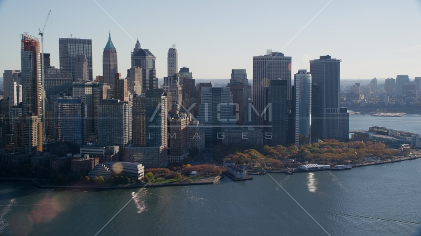 Battery Park and skyscrapers in Autumn, Lower Manhattan, New York City Aerial Stock Photos | AX119_015.0000096F