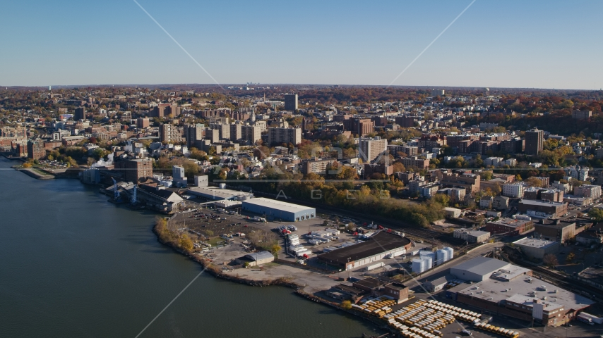 Riverfront warehouse buildings near downtown Yonkers, New York in Autumn Aerial Stock Photos | AX119_063.0000143F