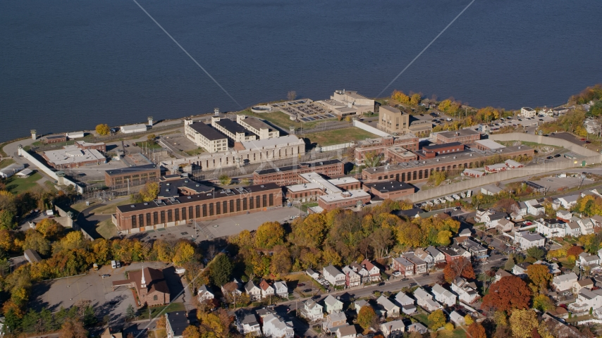 The riverfront Sing Sing Prison in Autumn, Ossining, New York Aerial Stock Photos | AX119_114.0000130F