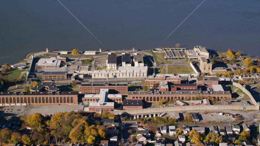 Sing Sing Prison beside the Hudson River in Autumn, Ossining, New York Aerial Stock Photos | AX119_115.0000090F