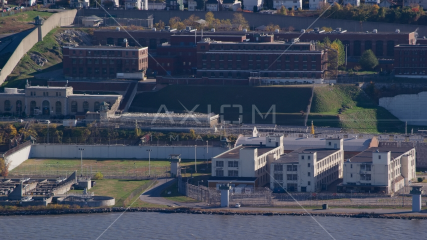 Riverfront buildings at Sing Sing Prison in Autumn, Ossining, New York Aerial Stock Photo AX119_123.0000182F | Axiom Images