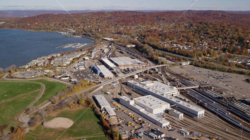 Riverfront rail station in Autumn, Croton on Hudson, New York Aerial Stock Photo AX119_129.0000094F | Axiom Images