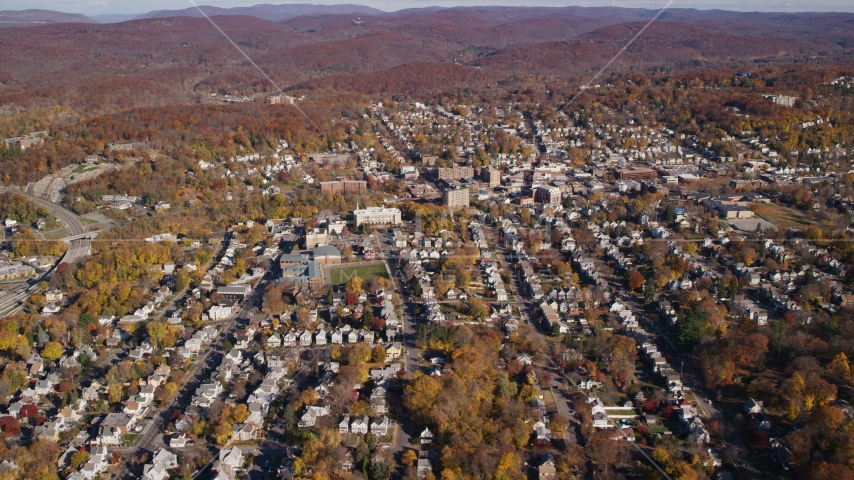 Small town residential neighborhoods in Autumn, Peekskill, New York Aerial Stock Photo AX119_145.0000103F | Axiom Images