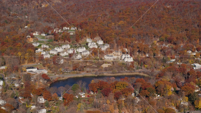 Condominium complexes overlooking Garrison Pond in Autumn, Fort Montgomery, New York Aerial Stock Photos AX119_157.0000152F | Axiom Images
