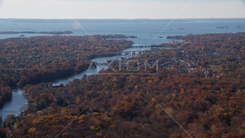 Small town community and bridges over Mianus River in Autumn, Greenwich, Connecticut Aerial Stock Photos | AX119_229.0000100F