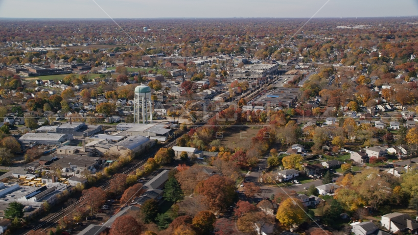 Industrial buildings and train tracks in Autumn, Farmingdale, New York Aerial Stock Photos AX119_255.0000120F | Axiom Images