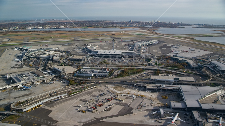 Control tower and terminals at JFK International Airport in Autumn, New York City Aerial Stock Photos AX120_053.0000124F