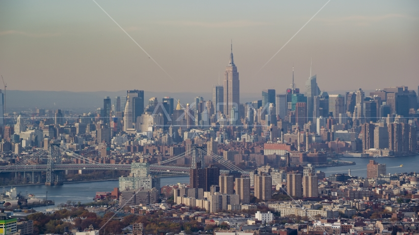 Midtown Manhattan skyline across the East River, seen from Brooklyn in Autumn, New York City Aerial Stock Photo AX120_083.0000197F | Axiom Images