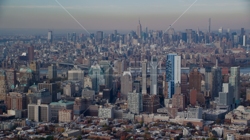 Downtown Brooklyn skyscrapers in Autumn, Midtown in the background, New York City Aerial Stock Photos AX120_087.0000088F | Axiom Images