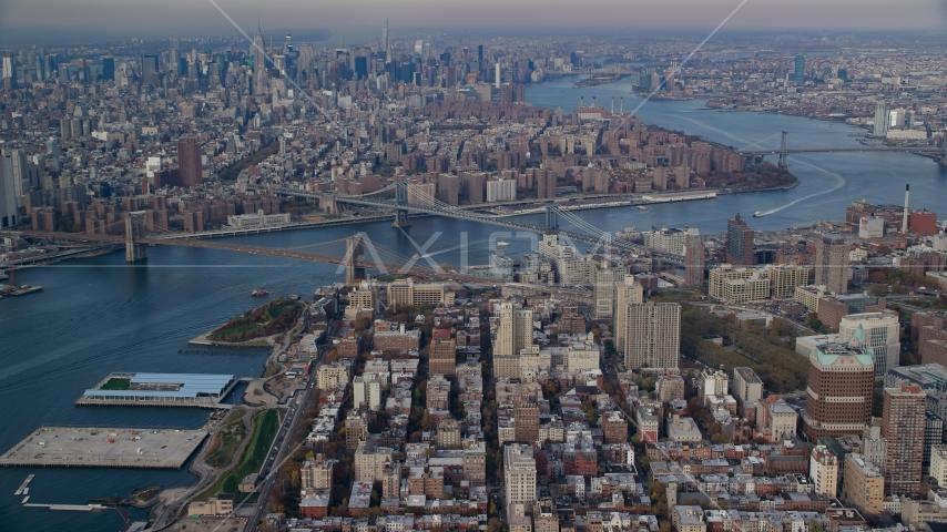 The Brooklyn and Manhattan Bridges spanning the East River in Autumn, New York City Aerial Stock Photos AX120_091.0000087F | Axiom Images