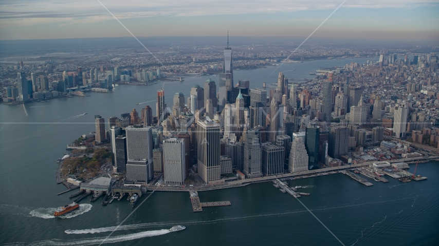 Lower Manhattan skyscrapers and rivers in Autumn, New York City Aerial Stock Photos | AX120_092.0000183F