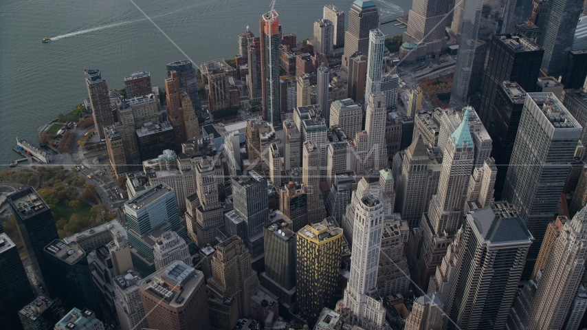 A view of Lower Manhattan skyscrapers and high-rise buildings in Autumn, New York City Aerial Stock Photos AX120_097.0000283F