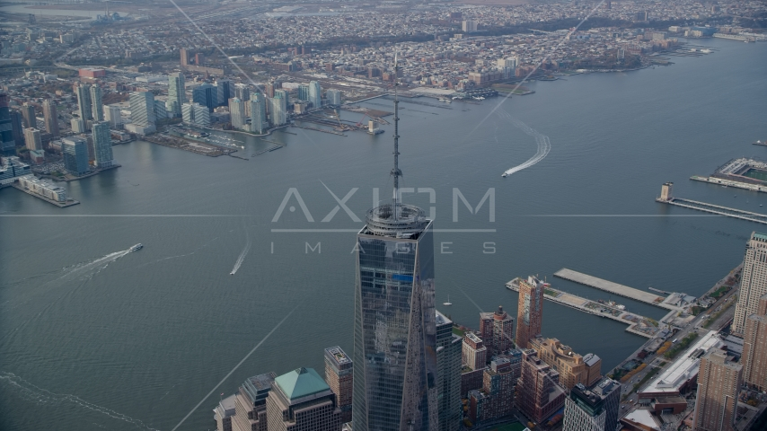 Top of One World Trade Center and the Hudson River in Lower Manhattan, New York City Aerial Stock Photo AX120_101.0000037F | Axiom Images