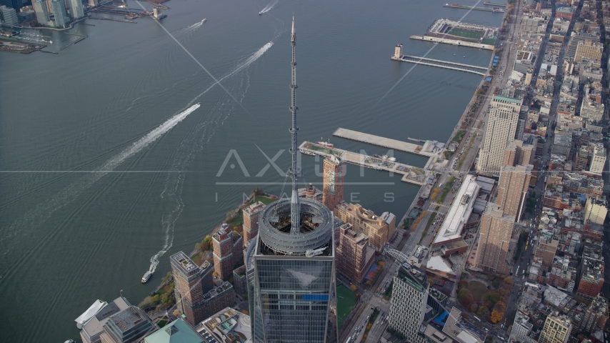 One World Trade Center spire and the Hudson River in Lower Manhattan, New York City Aerial Stock Photos AX120_109.0000324F