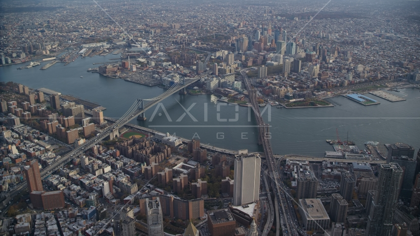 Brooklyn Bridge and Manhattan Bridge spanning the East River in New York City Aerial Stock Photos | AX120_113.0000091F