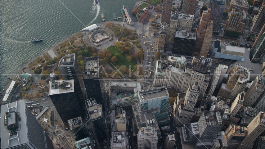 Bird's eye view of skyscrapers and Battery Park in Lower Manhattan, New York City Aerial Stock Photo AX120_118.0000185F | Axiom Images