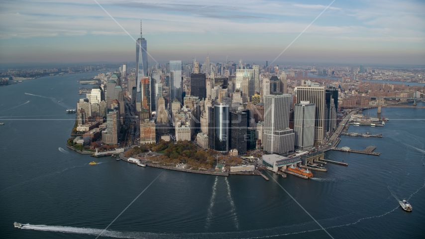 Battery Park and Lower Manhattan skyscrapers in Autumn, New York City Aerial Stock Photos | AX120_123.0000000F