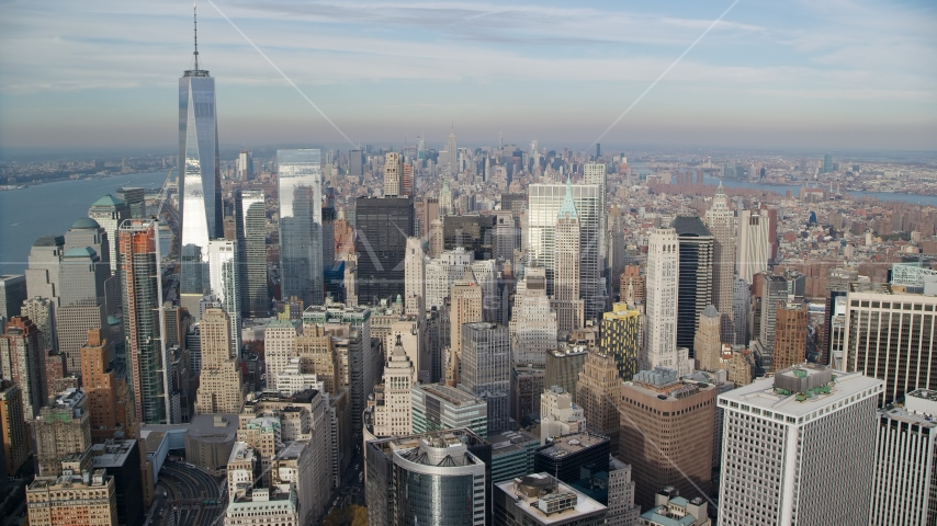 A view over the tops of Lower Manhattan skyscrapers, New York City Aerial Stock Photos | AX120_125.0000061F