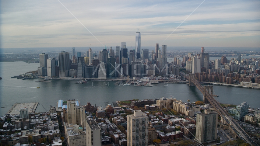 Lower Manhattan skyline across the East River, New York City Aerial Stock Photos | AX120_133.0000243F