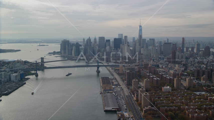 The Brooklyn and Manhattan Bridges beside Lower Manhattan, New York City Aerial Stock Photos | AX120_140.0000095F