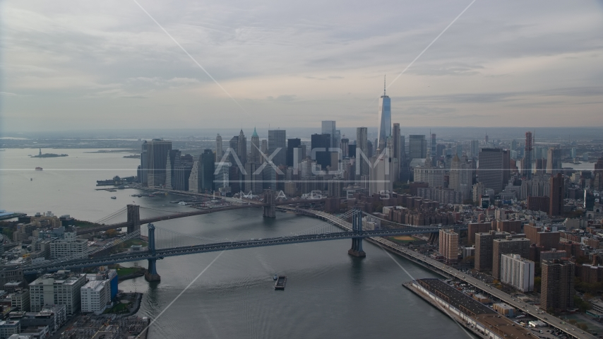 Lower Manhattan S=skyscrapers by the Brooklyn and Manhattan Bridges, New York City Aerial Stock Photo AX120_142.0000057F | Axiom Images