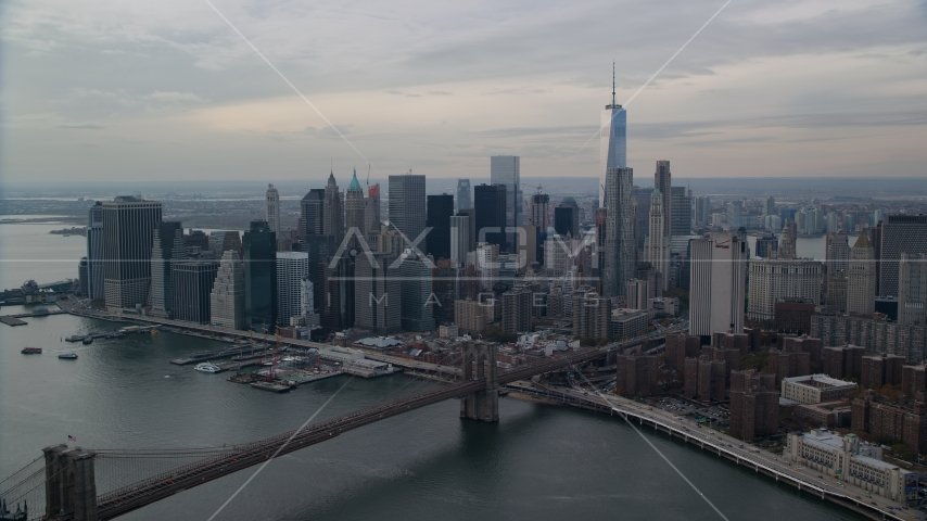 Brooklyn Bridge spanning East River by Lower Manhattan, New York City Aerial Stock Photo AX120_145.0000000F | Axiom Images