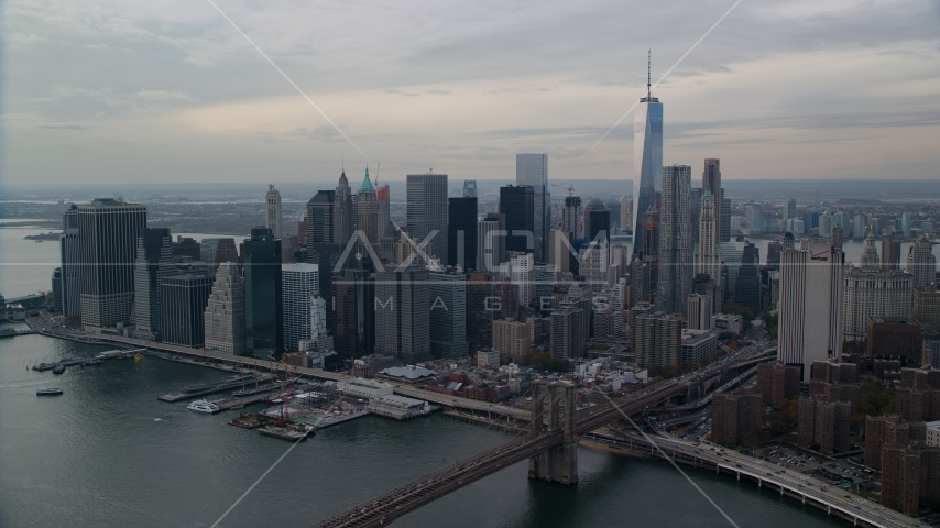 Part of the Brooklyn Bridge and Lower Manhattan skyscrapers, New York City Aerial Stock Photos | AX120_145.0000170F