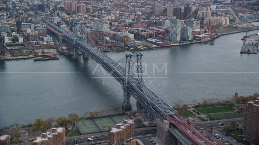The Williamsburg Bridge spanning the East River in Autumn, New York City Aerial Stock Photos | AX120_153.0000347F