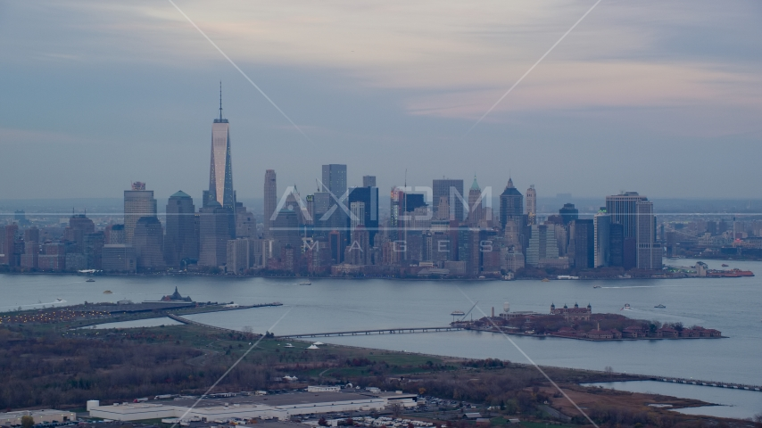 Lower Manhattan skyline and Ellis Island at sunset in Autumn, New York City Aerial Stock Photos | AX121_011.0000090F