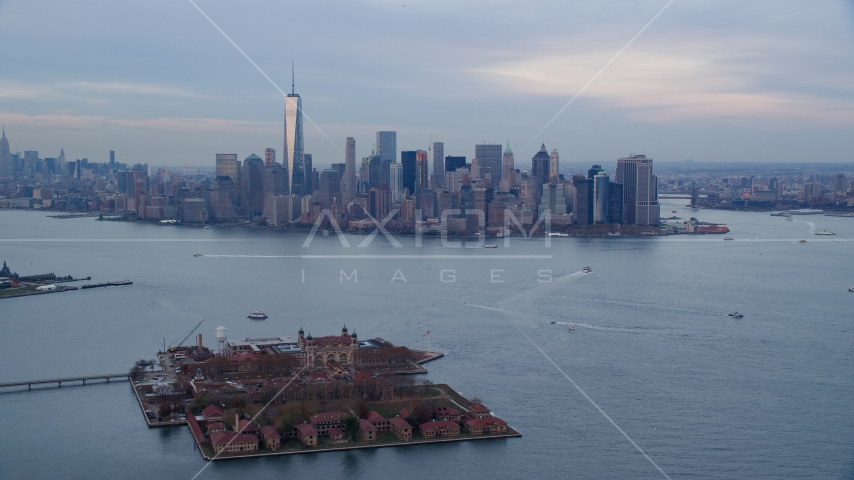 The Lower Manhattan skyline at sunset, New York City, seen from Ellis Island Aerial Stock Photo AX121_014.0000000F | Axiom Images