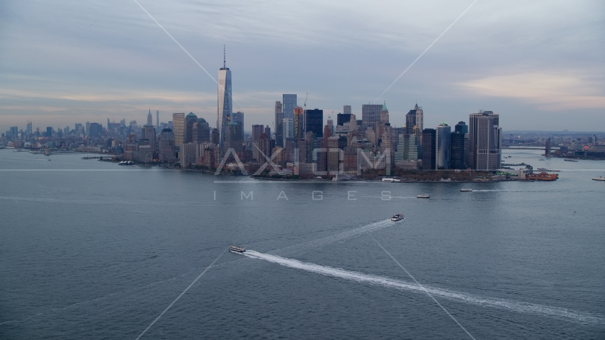 The Lower Manhattan skyline at sunset in Autumn, New York City, seen from New York Harbor Aerial Stock Photos | AX121_016.0000107F