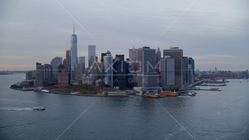 Battery Park, downtown skyline, and ferry terminal in Lower Manhattan at sunset, New York City Aerial Stock Photo AX121_019.0000105F | Axiom Images