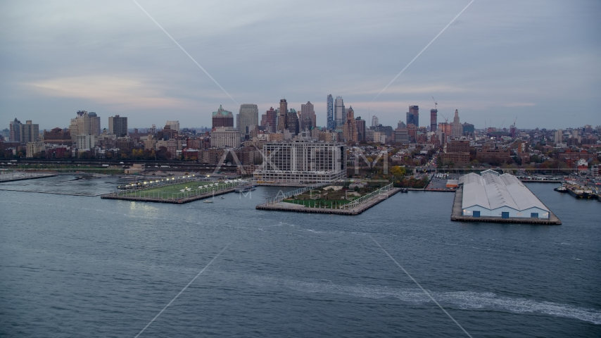 Piers 5 and 6 and Brooklyn skyline at sunset in New York City Aerial Stock Photo AX121_020.0000174F | Axiom Images
