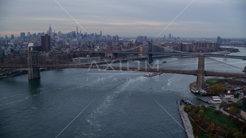 The Brooklyn and Manhattan Bridges at sunset in New York City Aerial Stock Photo AX121_023.0000020F | Axiom Images