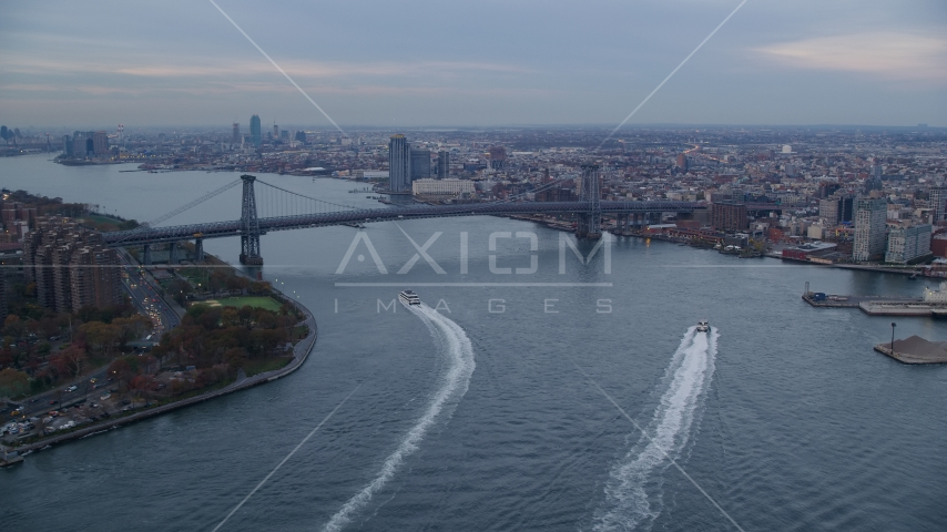 The Williamsburg Bridge and East River at sunset in New York City Aerial Stock Photo AX121_026.0000133F | Axiom Images