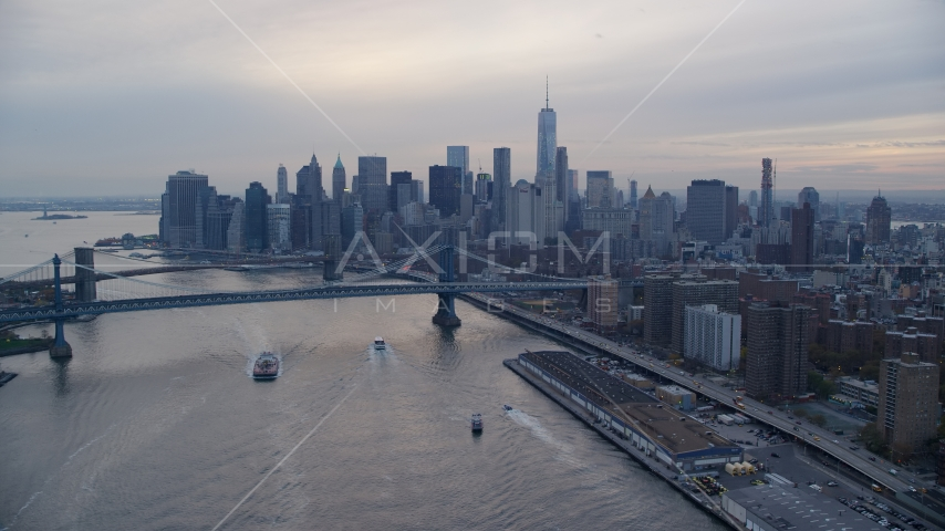 The Manhattan Bridge and the Lower Manhattan skyline at sunset in New York City Aerial Stock Photos | AX121_027.0000009F