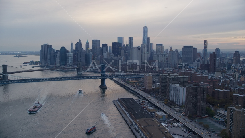 Manhattan Bridge and the Lower Manhattan skyline at sunset in New York City Aerial Stock Photos | AX121_027.0000270F